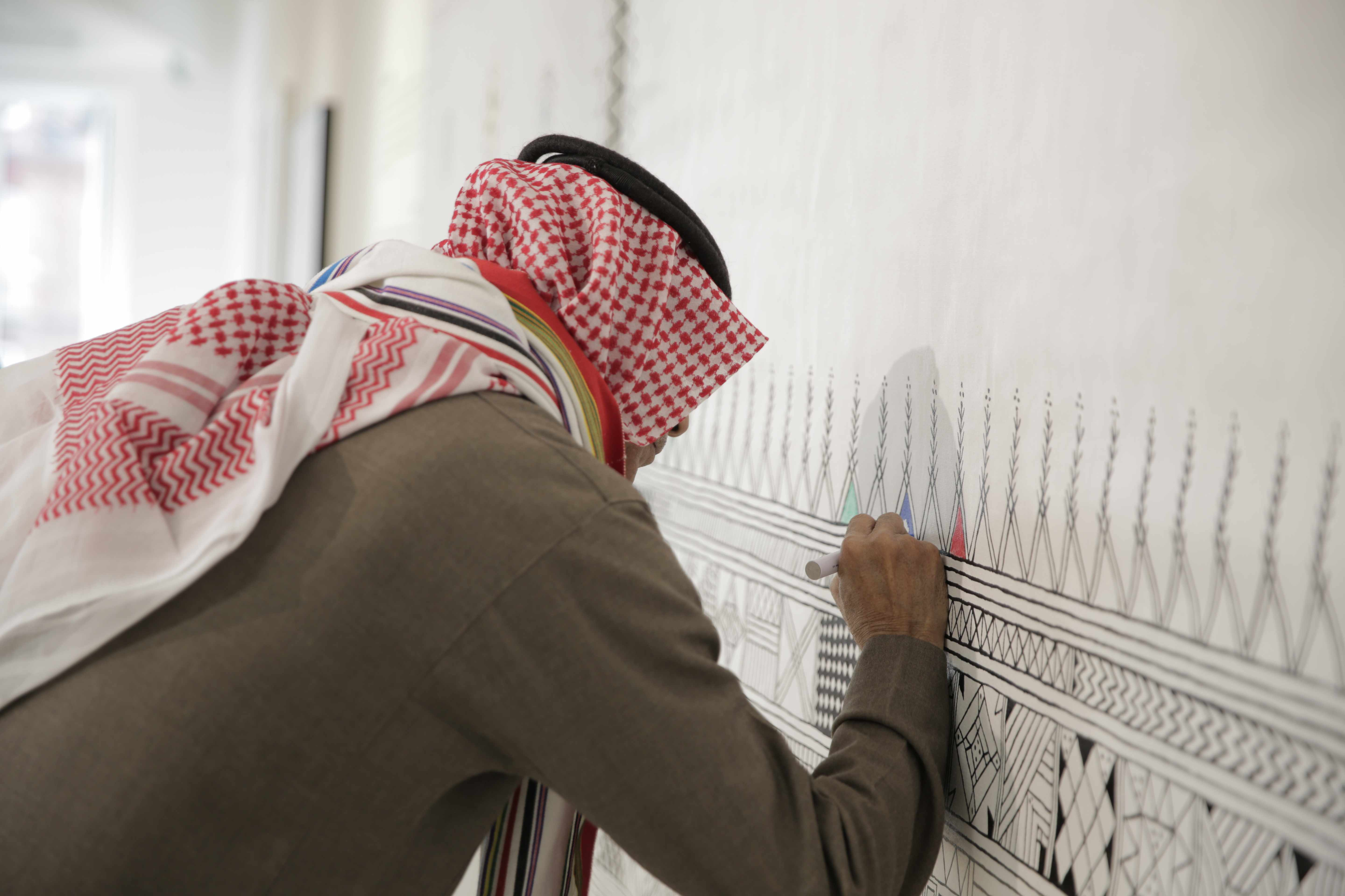 Performing the Saudi art, Alqatt Alasiri
