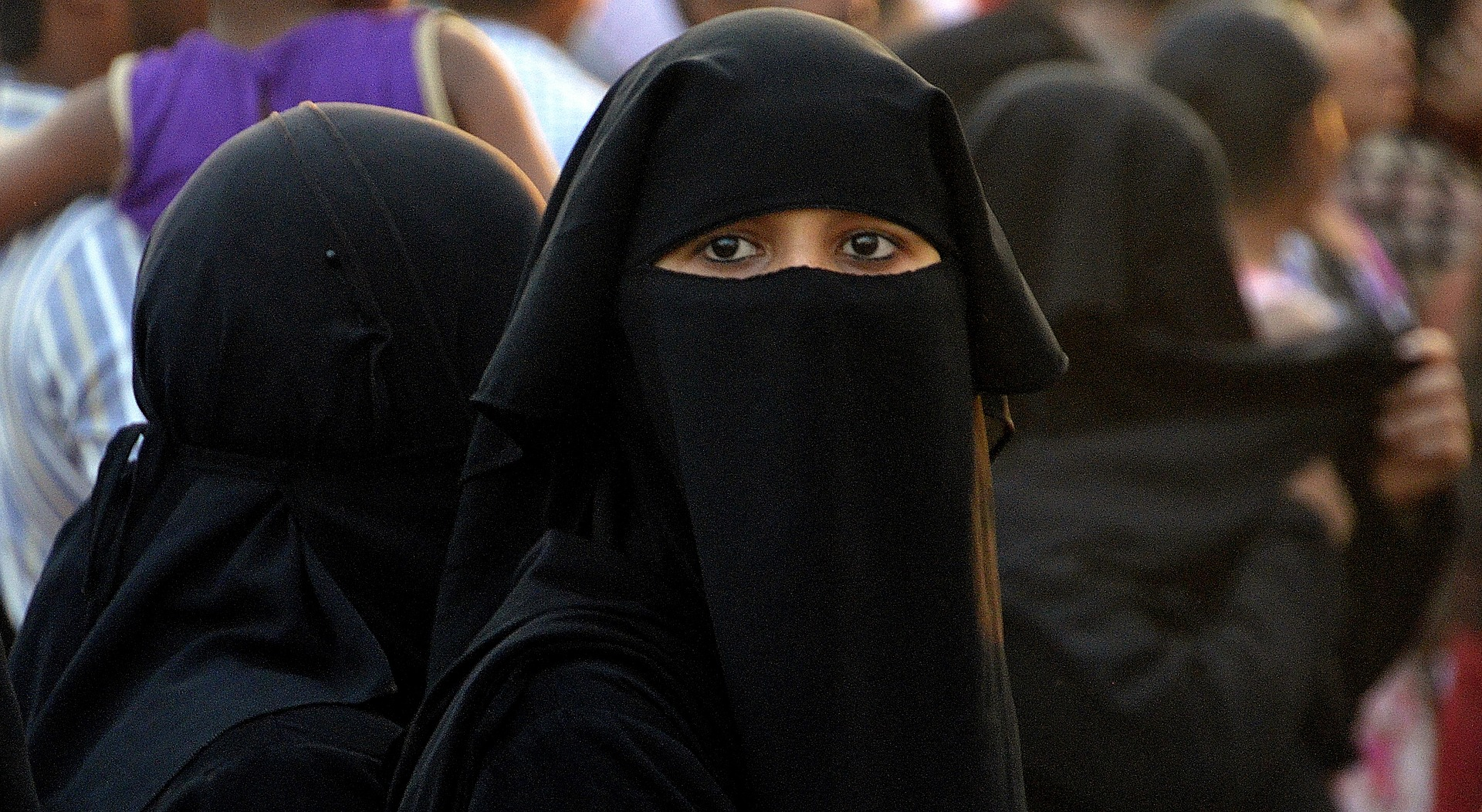 "Algeria bans the ""burqa"" for public service employees."