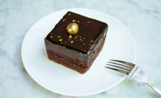 Chocolate cake with edible gold leaf for cake decorating © p_saranya