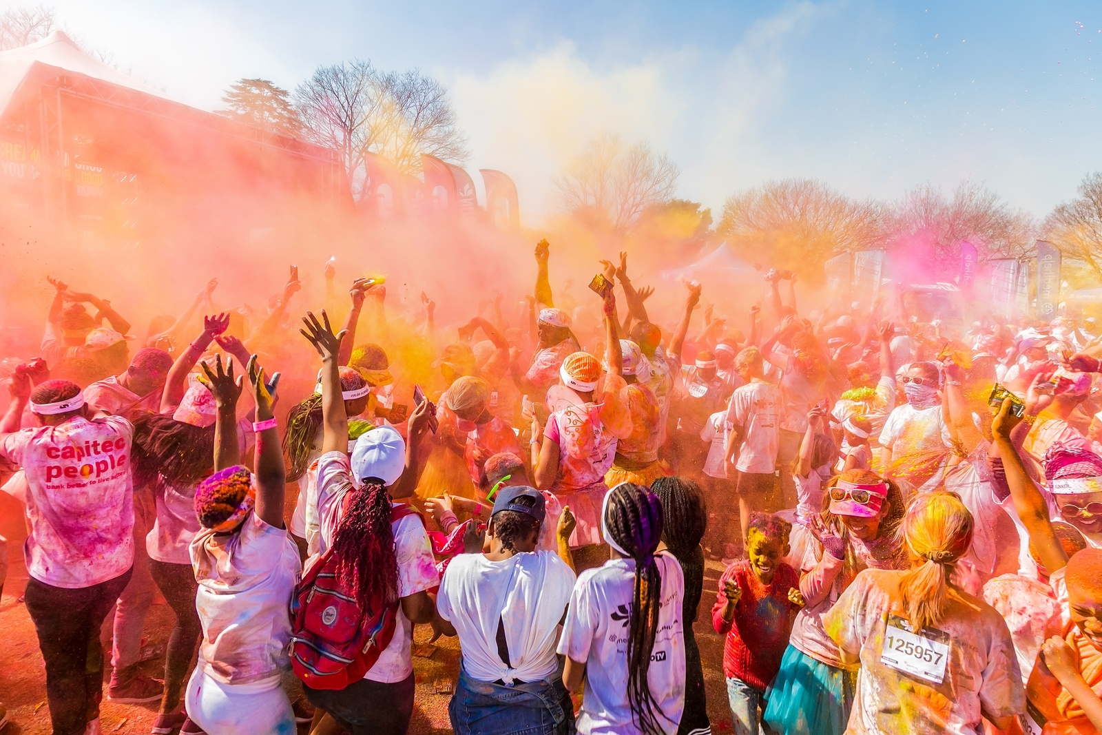 Johanneburg, South Africa, 05/21/2017, Young people having fun at The Color Run 5km Marathon, Bright color paint all over a large crowd © The Light Writer 33